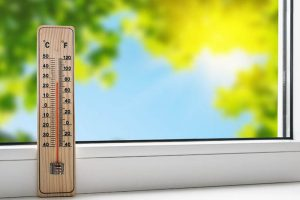 36540079 – thermometer on the windowsill on the background of the summer heat