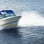 21536205 – man piloting motorboat on lake in georgian bay, ontario, canada.
