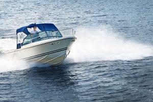 21536205 – man piloting motorboat on lake in georgian bay, ontario, canada.